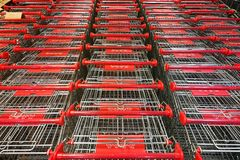 Abundant shopping cart trolley ready for use at supermarket. Abundant shopping cart trolley ready for consumers at supermarket royalty free stock photography