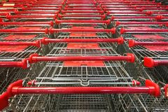 Abundant shopping cart trolley ready for use at supermarket. Abundant shopping cart trolley ready for consumers at supermarket royalty free stock photo