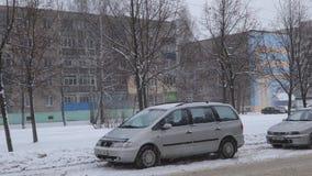 Abundant snow cover car along the road stock footage