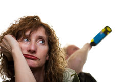Abuse. A middle aged woman with husband drinking in the background royalty free stock photos