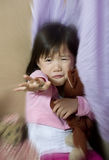 Abuse. A young asian child holds her hand up as defense from abuse Stock Photo