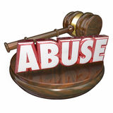Abuse 3d Word Judge Justice Gavel Criminal Court Case. Abuse word in red 3d letters beside a wooden gavel to illustrate a criminal court case sentence or verdict Royalty Free Stock Image