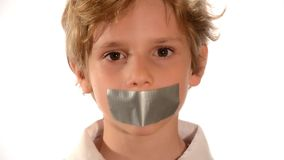 Abused child. Beautiful child with adhesive on his mouth isolated over white stock video footage