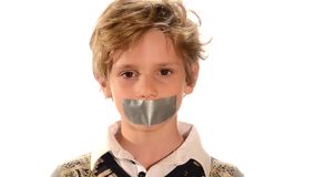 Abused child. Beautiful blond child with adhesive on his mouth isolated over white stock footage
