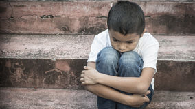 Abused child Stock Images