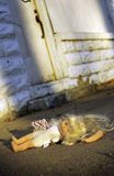 Abused doll lying on ground Royalty Free Stock Images