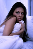 Abused at night. Young woman in bed abused at night stock photography