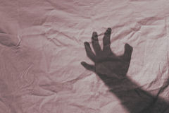 Abuso di assalto dell'ombra della mano Fotografie Stock