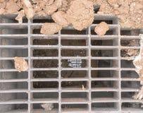 Abwassereinsteigeloch Stockbilder