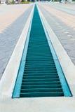Abwasserkanal-Deckel Stockfoto