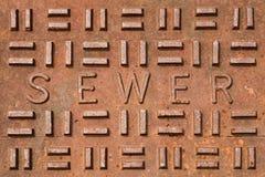 Abwasserkanal-Gitter-Nahaufnahme Stockfoto
