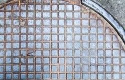 Abwasserkanallukenbeschaffenheit mit Rosthintergrund, Beschaffenheit, Weinlese Stockfotos