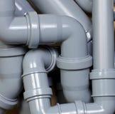 Abwasserrohrchaos Stockbilder