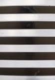 Abwechslung des hellen und dunklen Musters des gewölbten Metalls Stockbild