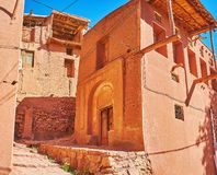 The ochre houses of Abyaneh, Iran. Abyaneh village consists of the narrow streets with preserved historic buildings, some are restored or wait for restoration royalty free stock images