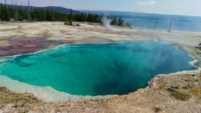 Abyss Pool Geyser - Yellowstone. A beautiful scene of the Abyss Pool hot spring landscape in the West Thumb geyser basin of Yellowstone National Park stock photo
