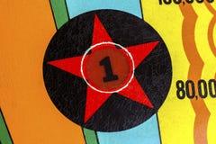 Abziehbildlicht der Zahl mit einem Stern auf Flipperautomatmaschine Stockfotos