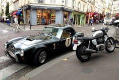 AC Cobra and Triumph motorbike Stock Image