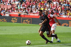 AC Milan vs Arsenal. Borriello and Gibbs, Milan and Arsenal players, fighting for the ball close to the line during the 2010 edition of the Emirates Cup royalty free stock photos