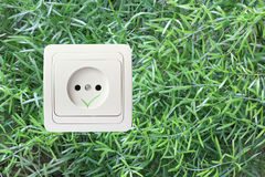 AC outlet on a green grass background Stock Photography