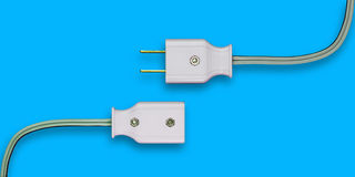 AC power plug. AC power plug with electrical cable. Isolate on blue background royalty free stock image