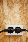 AC power plug and socket, wooden osb background Stock Photo
