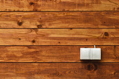 AC power socket on wooden wall Stock Photo