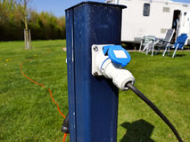 AC power sockets at a camping site, Full service campground elec Stock Photo