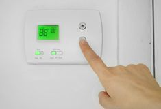AC thermostat adjust Stock Photos