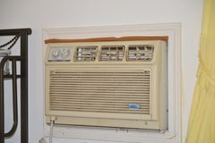 AC Unit inside home. Air conditioning and heating unit on the installed inside the exterior of a home Stock Photos