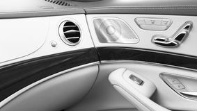 AC Ventilation Deck Luxury Car Interior. Door handle with Power seat control buttons of a luxury passenger car. White leather inte. Rior of the luxury modern car stock photos