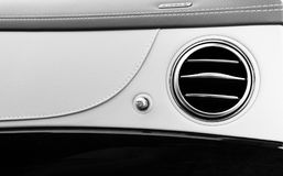 AC Ventilation Deck Luxury Car Interior. Modern car interior details white leather, natural wood. Black and white.  royalty free stock images