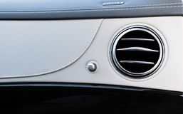 AC Ventilation Deck Luxury Car Interior. Modern car interior details white leather, natural wood.  stock photos