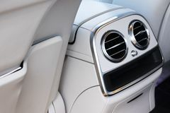 AC Ventilation Deck Luxury Car Interior. Modern car interior details white leather, natural wood.  stock photo