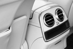 AC Ventilation Deck Luxury Car Interior. Modern car interior details white leather, natural wood. Car detailing. Black and white. AC Ventilation Deck Luxury Car stock photos