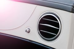 AC Ventilation Deck Luxury Car Interior. Modern car interior details white leather and natural wood. Soft lighting. AC Ventilation Deck Luxury Car Interior stock photography