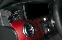 AC Ventilation Deck in Luxury modern Car Interior. Modern car interior details with red and black leather with red stitching. Carbon panel. Perforated leather stock image