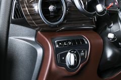 AC Ventilation Deck in Luxury modern Car Interior. Modern car interior details. Brown leather with white stitching. Carbon panel. Perforated leather. Steering stock photo