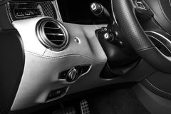 AC Ventilation Deck in Luxury modern Car Interior. Modern car interior details with leather stitching. Carbon panel. Perforated le. Ather steering wheel. Black royalty free stock photo
