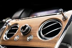 AC Ventilation Deck in Luxury modern car Interior. Modern car white leather interior. with stitching. Natural wood. Perforated lea. Ther. Car detailing. Car stock photos