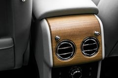 AC Ventilation Deck in Luxury modern car Interior. Modern car white leather interior. with stitching. Natural wood. Perforated lea. Ther. Car detailing. Car stock photo