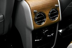 AC Ventilation Deck in Luxury modern car Interior. Modern car white leather interior. with stitching. Natural wood. Perforated lea. Ther. Car detailing. Car royalty free stock photos