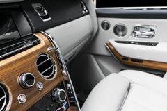 AC Ventilation Deck in Luxury modern car Interior. Modern car white leather interior. with stitching. Natural wood. Perforated lea. Ther. Car detailing. Car royalty free stock image