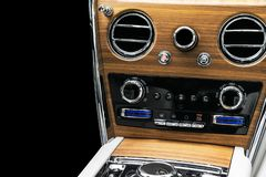 AC Ventilation Deck in Luxury modern car Interior. Modern car white leather interior. with stitching. Natural wood. Perforated lea. Ther. Car detailing. Car royalty free stock photo