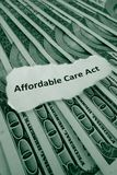 ACA. Closeup of Affordable Care Act, aka Obamacare text on money Royalty Free Stock Image