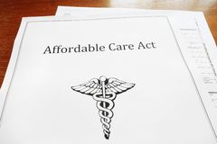 ACA document. Affordable Care Act / Obamacare document on a desk Royalty Free Stock Images