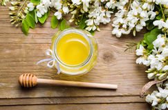 Acacia flowers and honey in the jar Stock Image
