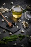 Acacia flowers and natural honey Stock Image