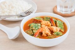 Acacia leave omelet and shrimp in sour soup and rice on plate. Acacia leave omelet and shrimp in spicy sour soup and rice on plate,  Thai food Stock Photo