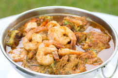Acacia Leave Omelet and Shrimps in Spicy Tamarind Flavored Soup. Royalty Free Stock Photography